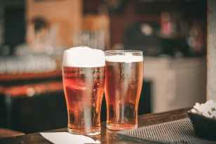 depth of field photo of two pilsner glasses